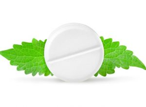 Aspirin with mint leaves isolated on white background